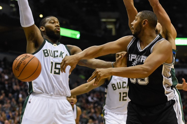 Jan 4, 2016; Milwaukee, WI, USA;  San Antonio Spurs center Boris Diaw (33) passes the ball around Milwaukee Bucks center Greg Monroe (15) in the fourth quarter at BMO Harris Bradley Center. Mandatory Credit: Benny Sieu-USA TODAY Sports