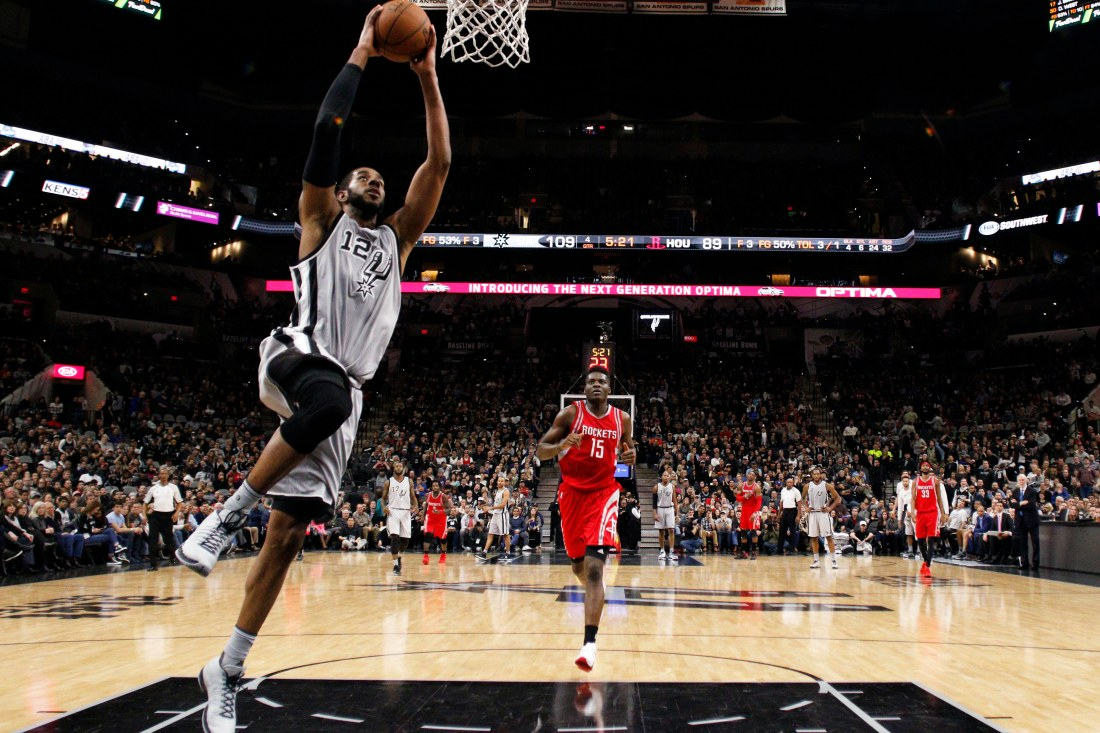 Jan 2, 2016; San Antonio, TX, USA; San Antonio Spurs power forward LaMarcus Aldridge (12) dunks the ball against the Houston Rockets during the second half at AT&T Center. Mandatory Credit: Soobum Im-USA TODAY Sports